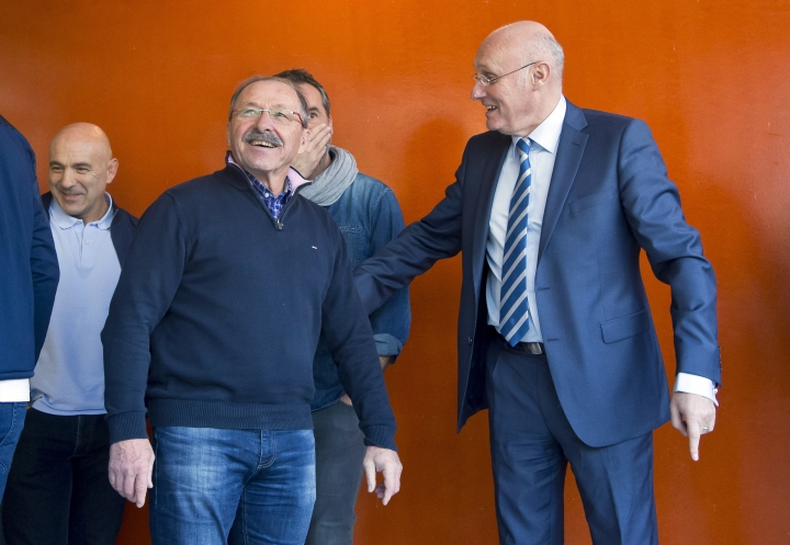 """New France Rugby coach Jacques Brunel, left, and French Rugby Federation President Bernard Laporte arrive for a group photo at the National Rugby Center in Marcoussis, south of Paris, Monday January 8, 2018. Brunel, who replaced Guy Noves last month, said during his first press conference on Monday that his ambition is """"to put France back to the level where it often was, so it will be among the Six Nations contenders every year."""" (AP Photo/Michel Euler)"""