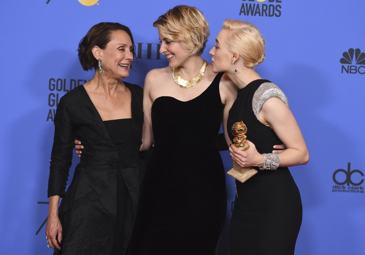 """Laurie Metcalf, from left, Greta Gerwig and Saoirse Ronan, winners of the award for best motion picture - musical or comedy for """"Lady Bird"""" pose in the press room at the 75th annual Golden Globe Awards at the Beverly Hilton Hotel on Sunday, Jan. 7, 2018, in Beverly Hills, Calif. Ronan also accepted the award for best performance by an actress in a motion picture - musical or comedy for """"Lady Bird"""". (Photo by Jordan Strauss/Invision/AP)"""