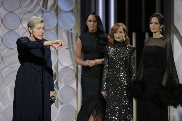 "This image released by NBC shows Frances McDormand, left, accepting the award for best actress in a motion picture drama for her role in ""Three Billboards Outside Ebbing, Missouri,"" at the 75th Annual Golden Globe Awards in Beverly Hills, Calif., on Sunday, Jan. 7, 2018. (Paul Drinkwater/NBC via AP)"