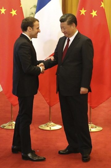 French President Emmanuel Macron shakes hands with Chinese President Xi Jinping during their meeting at the Great Hall of the People in Beijing, Jan. 9, 2018. (ludovic Marin/Pool Photo via AP)