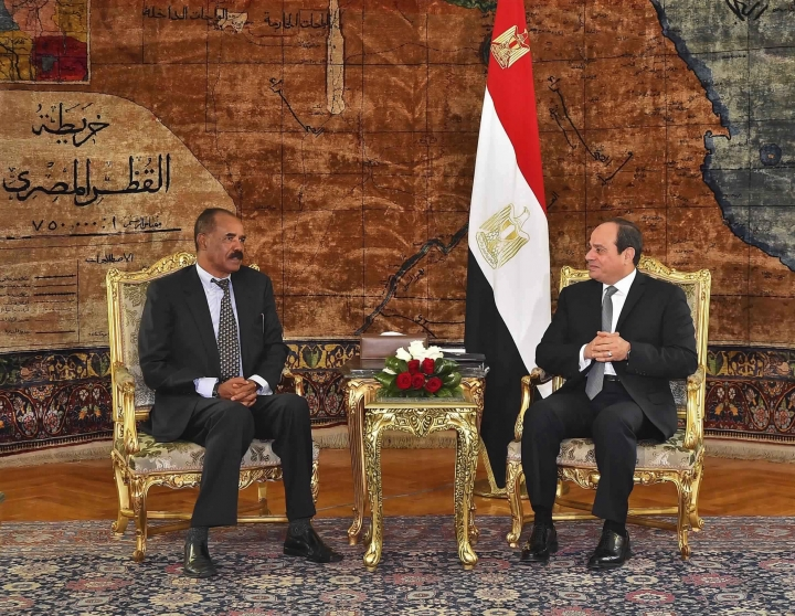 In this photo provided by Egypt's state news agency, MENA, Eritrean President Isaias Afwerki, left, meets with Egyptian President Abdel-Fattah el-Sissi at the presidential palace, in Cairo, Egypt, Tuesday, Jan. 9, 2018. The two presidents met amid heightened tensions with Sudan and Ethiopia over border disputes and the construction of a massive upstream dam on the Nile. Egypt fears the soon-to-be completed multi-billion-dollar dam in Ethiopia could cut into its share of the river, which provides nearly all its freshwater. (MENA via AP)