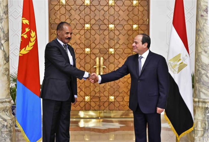 In this photo provided by Egypt's state news agency, MENA, Eritrean President Isaias Afwerki, left, shakes hands with Egyptian President Abdel-Fattah el-Sissi at the presidential palace, in Cairo, Egypt, Tuesday, Jan. 9, 2018. The two presidents met amid heightened tensions with Sudan and Ethiopia over border disputes and the construction of a massive upstream dam on the Nile. Egypt fears the soon-to-be completed multi-billion-dollar dam in Ethiopia could cut into its share of the river, which provides nearly all its freshwater. (MENA via AP)
