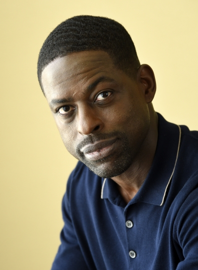 "FILE - In this Aug. 3, 2017 file photo, actor Sterling K. Brown, a cast member in the NBC series ""This Is Us,"" poses for a portrait in Beverly Hills, Calif. Brown won a Golden Globe Award for best actor in a TV drama series for his role on the show. He is the first African American man to win in this category. (Photo by Chris Pizzello/Invision/AP, File)"
