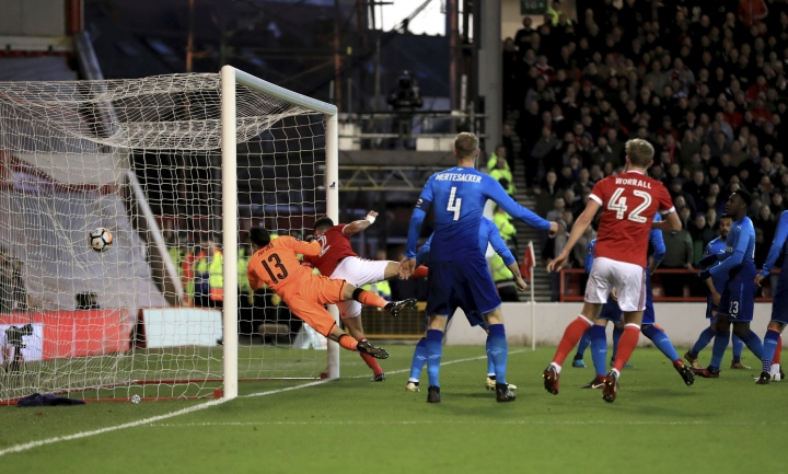 Nottingham Forest's Eric Lichaj scores his side's first goal of the game during the English FA Cup, Third Round soccer match between Nottingham Forest and Arsenal at the City Ground, Nottingham, England, Sunday, Jan. 7, 2018. (Mike Egerton/PA via AP)