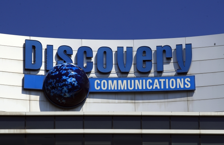 FILE - In this Monday, July 31, 2017, file photo, the Discovery Communications logo sits atop its headquarters in Silver Spring, Md. Discovery Communications, the company that operates the Discovery Channel, Animal Planet, TLC and other popular cable channels, announced Tuesday, Jan. 9, 2018, that it plans to relocate its global headquarters from Maryland to New York City, in 2019. (AP Photo/Manuel Balce Ceneta, File)
