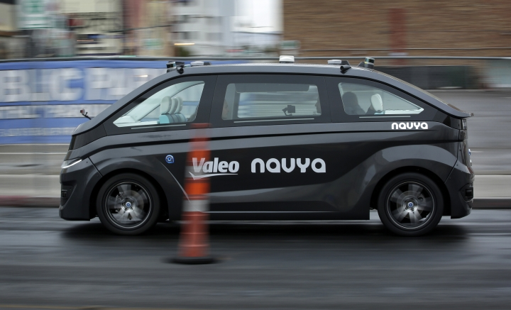 A Navya Autonom Cab, a self-driving vehicle, drives down a street during a demonstration at CES International, Monday, Jan. 8, 2018, in Las Vegas. (AP Photo/John Locher)