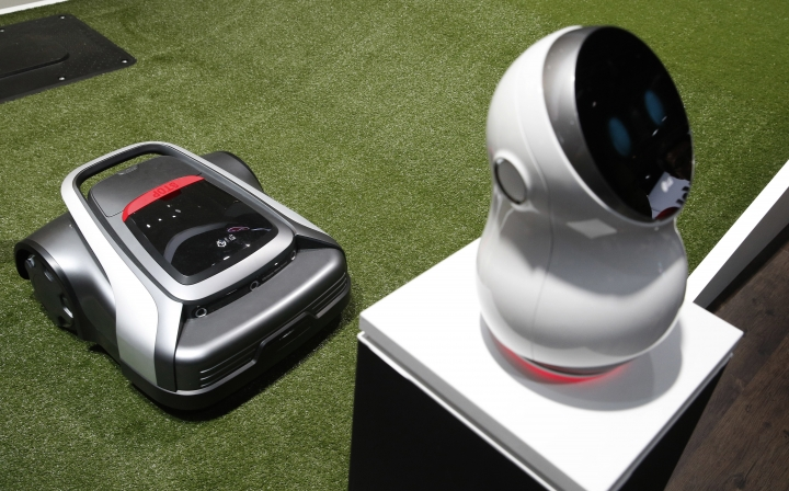 A Cloi controlled lawn mower appears on display at the LG booth during CES International, Tuesday, Jan. 9, 2018, in Las Vegas. (AP Photo/John Locher)