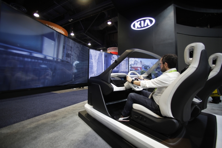 An attendee tests the Human Machine Interface platform at the Kia booth at CES International, Tuesday, Jan. 9, 2018, in Las Vegas. (AP Photo/Jae C. Hong)