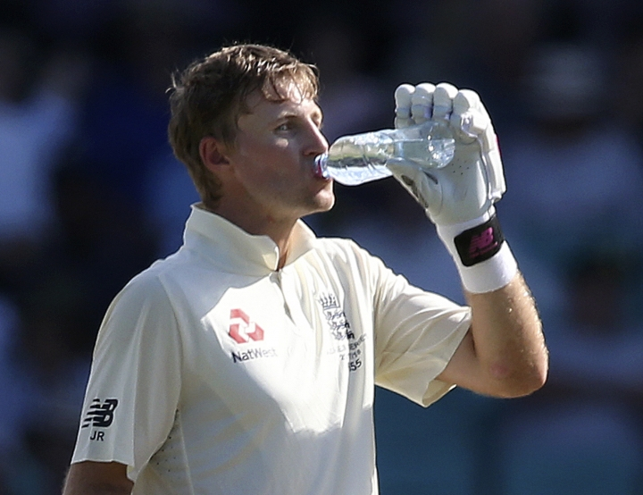 FILE - In this Jan 7, 2018, file photo, England's Joe Root drinks during a break in play against Australia during the fourth day of their Ashes cricket test match in Sydney. Roots was hospitalized with severe dehydration later Sunday, which was Sydney's hottest day in almost 80 years with a high of 47.3 degrees Celsius (117 degrees Fahrenheit). The Australian Bureau of Meteorology said in its annual climate statement on Wednesday, Jan. 10, 2018, that 2017 was the nation's hottest year since 1910. (AP Photo/Rick Rycroft, File)