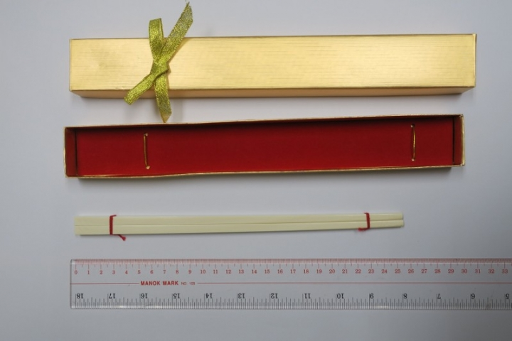 One of the pairs of ivory chopsticks, made with ivory obtained after the 1990 ban, is shown in Hong Kong, China, November 27, 2017. Picture taken November 27, 2017. Government Services Department/Handout via REUTERS