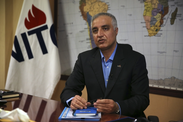 Mohsen Bahrami, a spokesman for National Iranian Tanker Company, NITC, speaks during an interview with The Associated Press at the headquarters of the NITC, in Tehran, Iran, Tuesday, Jan. 9, 2018. The Iranian company whose oil tanker burst into flames after a collision in the East China Sea says there is still hope of finding survivors. (AP Photo/Vahid Salemi)