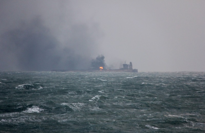 Smoke is seen from Panama-registered Sanchi tanker carrying Iranian oil that caught ablaze after it collided with a Chinese freight ship in the East China Sea, in this January 9, 2018 handout picture released by China's Ministry of Transport.  China's Ministry of Transport/Handout via REUTERS