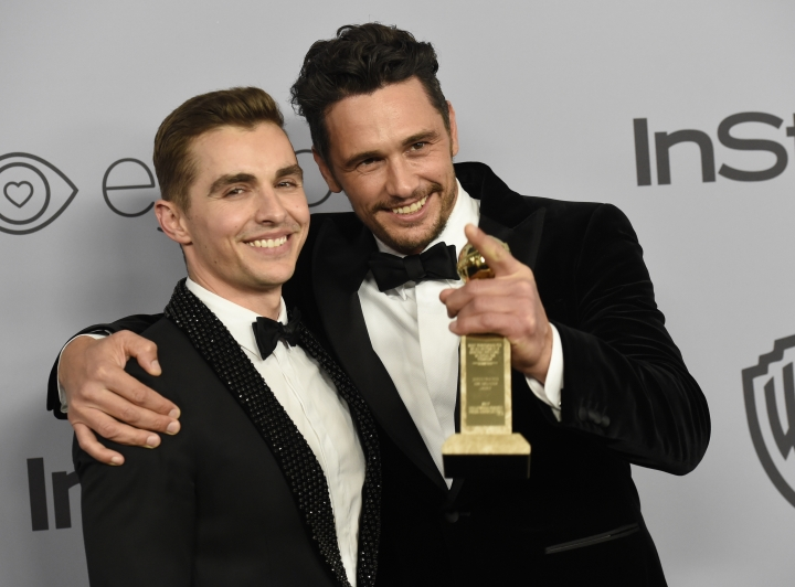 "FILE - In this Jan. 7, 2018, file photo, Dave Franco, left, poses with James Franco, winner of the award for best performance by an actor in a motion picture - musical or comedy for ""The Disaster Artist,"" at the InStyle and Warner Bros. Golden Globes afterparty in Beverly Hills, Calif. The New York Times has canceled a public event with James Franco days after the Golden Globe winner was accused of sexual misconduct. The TimesTalk event scheduled for Wednesday, Jan. 10, was intended to feature ""The Disaster Artist"" director and star and his brother and co-star, Dave Franco, discussing the film with a Times reporter. The Times said in a statement that ""given the controversy surrounding recent allegations"" it was canceling the event. (Photo by Chris Pizzello/Invision/AP, File)"