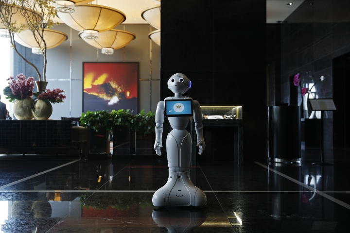 In this Nov. 15, 2017, photo, a robot named Pepper stands in the lobby of the Mandarin Oriental in Las Vegas. Pepper is programmed to interact with guests and answer pre-programmed questions. (AP Photo/John Locher)