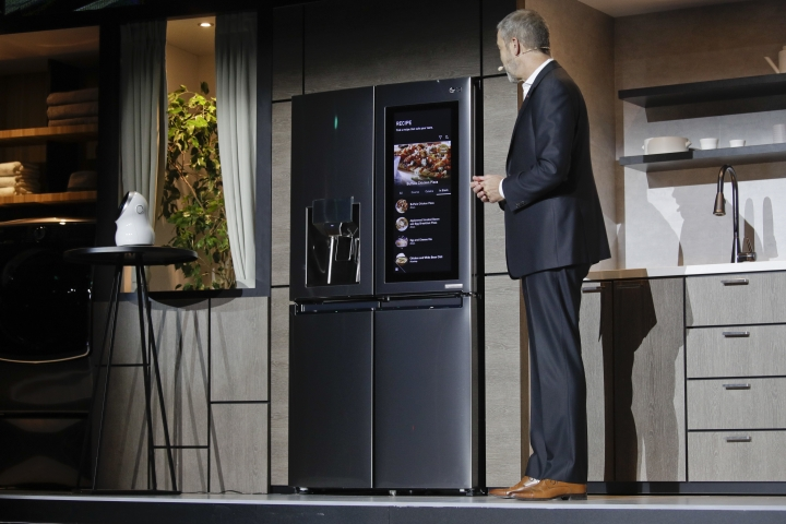 LG's David Vander Waal introduces the InstaView ThinQ smart refrigerator during a news conference at CES International, Monday, Jan. 8, 2018, in Las Vegas. (AP Photo/Jae C. Hong)
