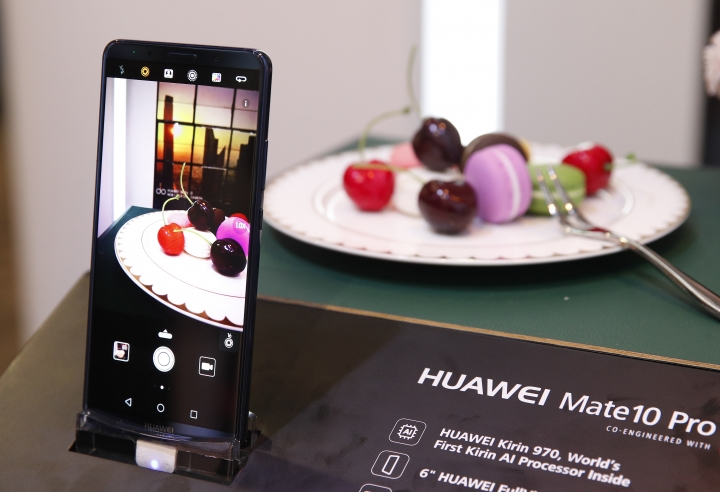 The Huawei Mate10 Pro phone is on display at the Huawei booth during CES International, Tuesday, Jan. 9, 2018, in Las Vegas. (AP Photo/John Locher)