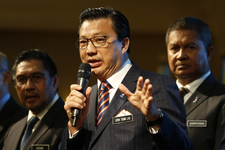 Malaysian Minister of Transport, Liow Tiong Lai, center, speaks during the signing ceremony of the MH370 missing plane search operations between Malaysian government and Ocean Infinity Limited in Putrajaya, Malaysia, Wednesday, Jan. 10, 2018. (AP Photo/Sadiq Asyraf)