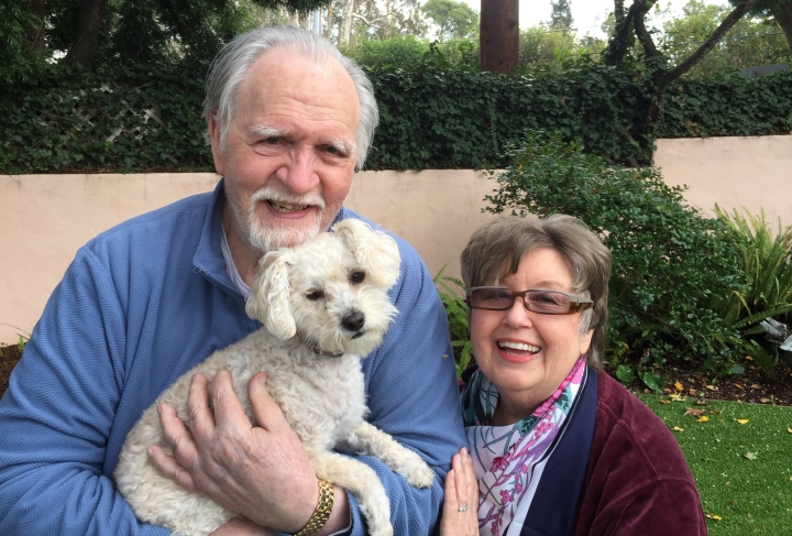 This January 2017, photo provided by Kelly Weimer, shows Jim Mitchell, 89, with his wife, Alice Mitchell, 78, and their dog, Gigi. The Mitchell's and their dog have been missing since Tuesday, Jan. 9, 2018, when their Montecito, Calif., home was swept away by the torrent of mud, trees and boulders that flowed down a fire-scarred mountain and slammed into the coastal town in Santa Barbara County. (Kelly Weimer via AP)