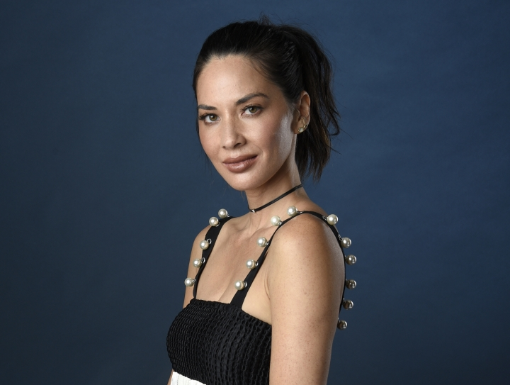 FILE - In this July 21, 2017 file photo, actress Olivia Munn poses for a portrait at Comic-Con International in San Diego. Munn is hosting the Critics' Choice Awards on Thursday, Jan. 11, 2018. (Photo by Chris Pizzello/Invision/AP, File)