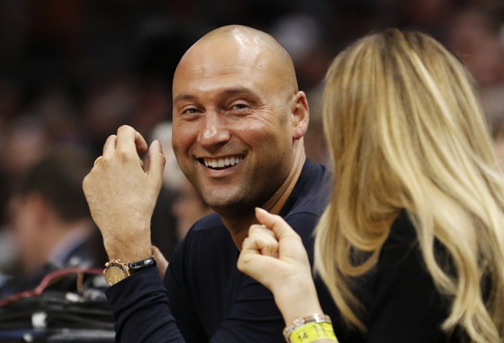 "FILE - In this Dec. 3, 2017, file photo, Derek Jeter, chief executive officer and part owner of the Miami Marlins and former New York Yankees player, sits court side as the Miami Heat played against the Golden State Warriors in an NBA basketball game, in Miami. The latest acquisition by Jeter's publishing imprint: A memoir by Robert Scheer, founder of the foster youth charity Comfort Cases. Jeter Publishing told The Associated Press on Thursday, Jan. 11, 2018, that Sheer's ""A Forever Family"" will come out in November. (AP Photo/Joe Skipper, File)"