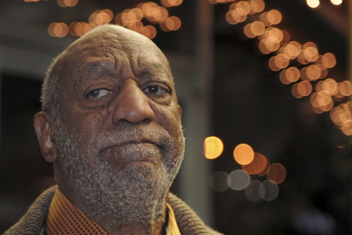 In this Wednesday, Jan. 10, 2018 photo, Bill Cosby pauses to talk to reporters as he leaves following a dinner at an Italian restaurant in Philadelphia. Cosby's new trial on charges he drugged and molested a woman in 2004 was supposed to begin in November, but was delayed until this spring so his new legal team could get up to speed. Jurors deadlocked in June and the judge declared a mistrial. He has said the encounter was consensual. (Tim Gralish/The Philadelphia Inquirer via AP)