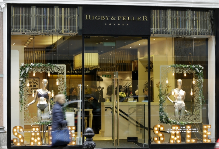 "A general view of lingerie boutique Rigby&Peller in Chelsea London, Thursday, Jan. 11, 2018. The luxury bra maker that supplied lingerie to Queen Elizabeth II has lost its royal warrant after a book described the atmosphere at Buckingham Palace. Rigby&Peller can no longer display the royal coat of arms after ex-owner, June Kenton, mentioned the royals in ""Storm in a D-cup.''. (AP Photo/Alastair Grant)"
