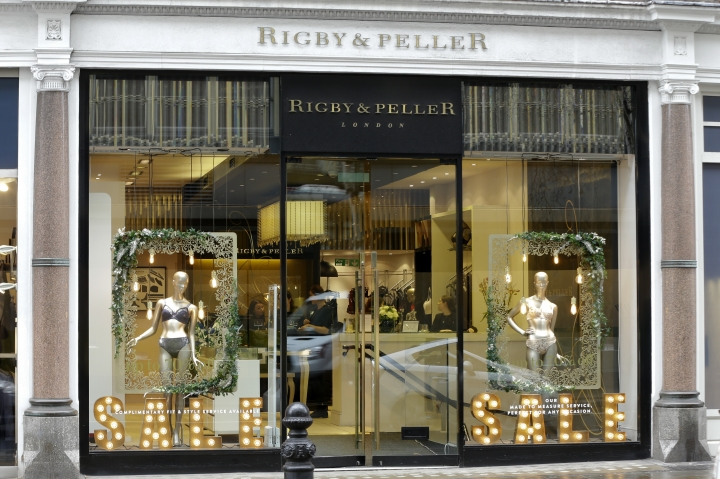 "A general view of lingerie boutique Rigby&Peller in Chelsea London, Thursday, Jan. 11, 2018. June Kenton the former owner of a luxury British bra maker that supplied lingerie to Queen Elizabeth II said the company lost its royal warrant after a book disclosed details of fittings at Buckingham Palace. Kenton said Rigby & Peller lost its right to display the royal coat of arms in 2016 after she mentioned the royals in ""Storm in a D-cup."" The book recounts her first meeting with the monarch and her trepidation about being ushered into the royal bedroom. (AP Photo/Alastair Grant)"