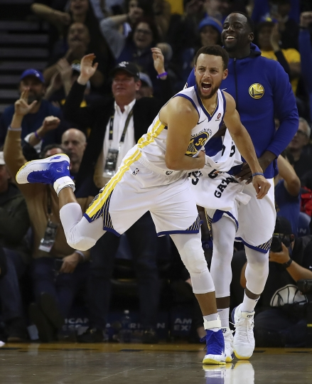 Golden State Warriors' Stephen Curry (30) and Draymond Green celebrate a score against the Denver Nuggets during the second half of an NBA basketball game Monday, Jan. 8, 2018, in Oakland, Calif. (AP Photo/Ben Margot)