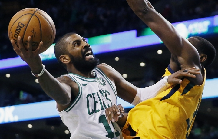 FILE - In this Dec. 15, 2017, file photo, Boston Celtics' Kyrie Irving (11) shoots against Utah Jazz's Ekpe Udoh during the fourth quarter of an NBA basketball game in Boston. When the Boston Celtics and Philadelphia 76ers take center stage in London on Thursday, Jan. 11, 2018, they'll be a little more on the line than trying to get a victory and the league spreading its global brand. There may be a few All-Star votes to be had. (AP Photo/Michael Dwyer, File)