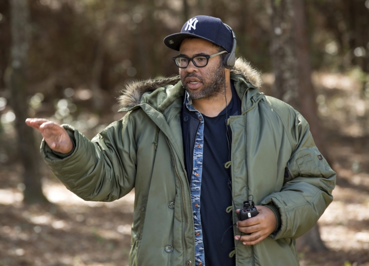 "This image released by Universal Pictures shows director Jordan Peele on the set of ""Get Out."" Peele is nominated for outstanding directorial achievement by the Directors Guild of America for his direction on the film. He is also nominated for outstanding directorial achievement for a first-time feature film director. (Justin Lubin/Universal Pictures via AP)"