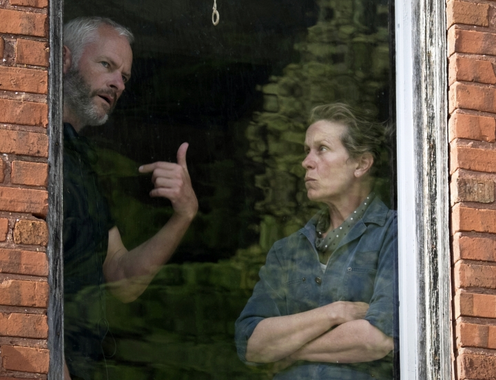 "This image released by Fox Searchlight Pictures shows writer-director Martin McDonagh, left, with actor Frances McDormand on the set of ""Three Billboards Outside Ebbing, Missouri."" McDonagh is nominated for outstanding directorial achievement by the Directors Guild of America for his direction on the film. (Merrick Morton/Fox Searchlight via AP)"