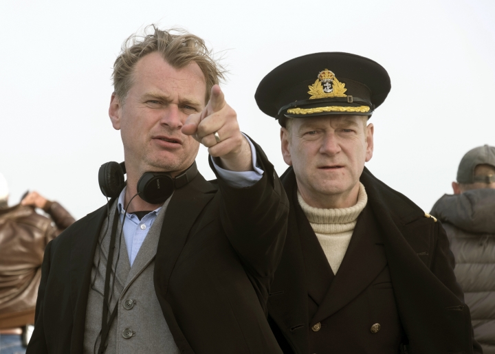 """This image released by Warner Bros. Pictures shows director Christopher Nolan, left, on the set of """"Dunkirk."""" Nolan is nominated for outstanding directorial achievement by the Directors Guild of America for his direction on the film. (Melinda Sue Gordon/Warner Bros. Pictures via AP)"""
