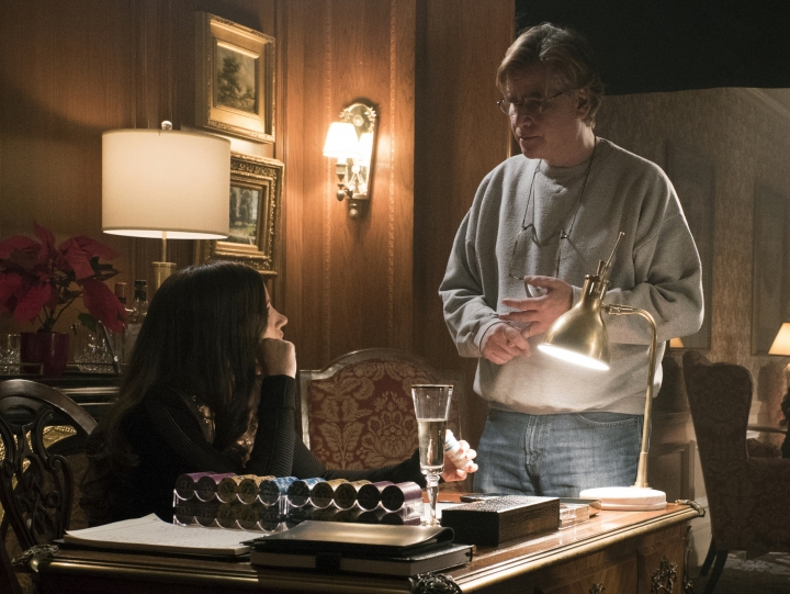 """This image released by STXfilms shows Jessica Chastain, left, with director Aaron Sorkin on the set of """"Molly's Game."""" Sorkin is nominated for the Directors Guild of America Award for outstanding directorial achievement of a first-time feature film director. (Michael Gibson/STXfilms via AP)"""