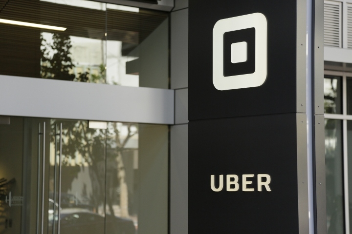 FILE - This Wednesday, June 21, 2017, file photo shows the building that houses the headquarters of Uber in San Francisco. A published report says Uber used technology during police raids outside the U.S. to keep company information from law enforcement. (AP Photo/Eric Risberg, File)