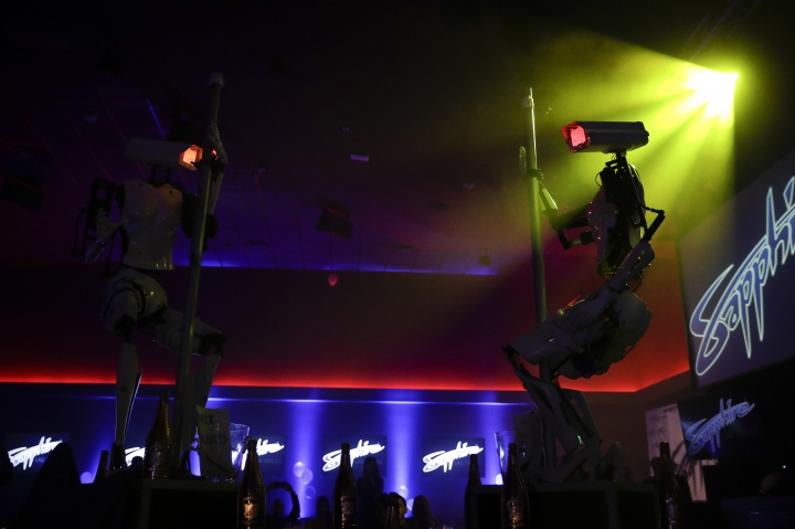 Two pole-dancing robots built by British artist Giles Walker perform at a gentlemen's club Monday, Jan. 8, 2018, in Las Vegas. The event was held to coincide with CES International. (AP Photo/Jae C. Hong)
