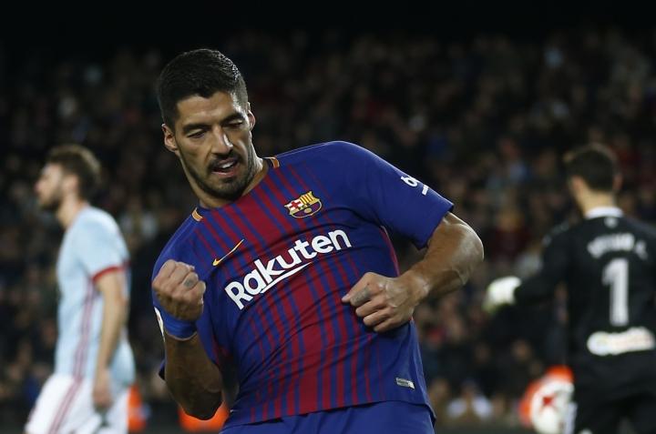 FC Barcelona's Luis Suarez celebrates after scoring during the Spanish Copa del Rey round of 16 second leg soccer match between FC Barcelona and Celta de Vigo at the Camp Nou stadium in Barcelona, Spain, Thursday, Jan. 11, 2018. (AP Photo/Manu Fernandez)