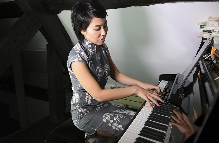 This September 2017 photo provided by Léa Girardin shows pianist Jenny Q. Chai in Paris, France. Chai said she encountered conductor Charles Dutoit by chance after a Philadelphia Orchestra concert in the early 2000s. She had gone backstage hoping to meet acclaimed pianist Martha Argerich, one of Dutoit's ex-wives, but instead was greeted by the conductor, who she said spoke with her, then leaned forward, kissing her cheeks and lips and trying to put his tongue in her mouth while touching her body. (Léa Girardin via AP)