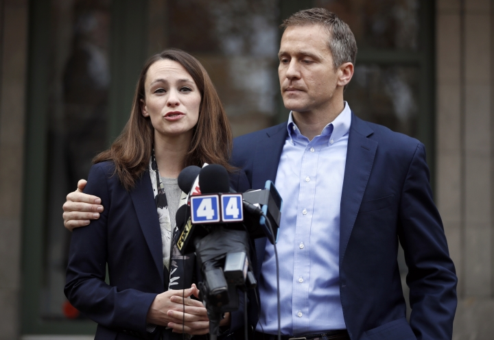 "FILE - In this Dec. 6, 2016, file photo, Missouri Gov.-elect Eric Greitens and his wife Sheena speak to the media in St. Louis after she had been robbed at gunpoint the day before. Responding to a news report that overshadowed his annual State of the State address Wednesday night, Jan. 10, 2018, the Republican governor acknowledged he's been ""unfaithful"" in his marriage but denied allegations that he blackmailed the woman to stay quiet. The couple released a statement late Wednesday after the report that he had a sexual relationship with his former hairdresser in 2015. (AP Photo/Jeff Roberson, File)"