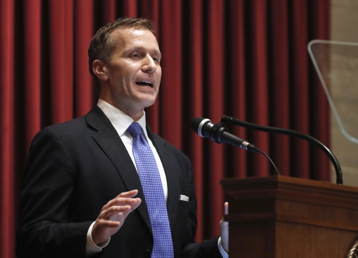 "FILE - In this Jan. 10, 2018, file photo, Missouri Gov. Eric Greitens delivers the annual State of the State address to a joint session of the House and Senate in Jefferson City, Mo. Responding to a news report that overshadowed his annual address, Greitens acknowledged he's been ""unfaithful"" in his marriage but denied allegations that he blackmailed the woman to stay quiet. The Republican governor and his wife released a statement late Wednesday, after a report that he had a sexual relationship with his former hairdresser in 2015. (AP Photo/Jeff Roberson, File)"