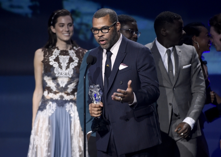 """Jordan Peele accepts the award for best sci-fi or horror movie for """"Get Out"""" at the 23rd annual Critics' Choice Awards at the Barker Hangar on Thursday, Jan. 11, 2018, in Santa Monica, Calif. (Photo by Chris Pizzello/Invision/AP)"""