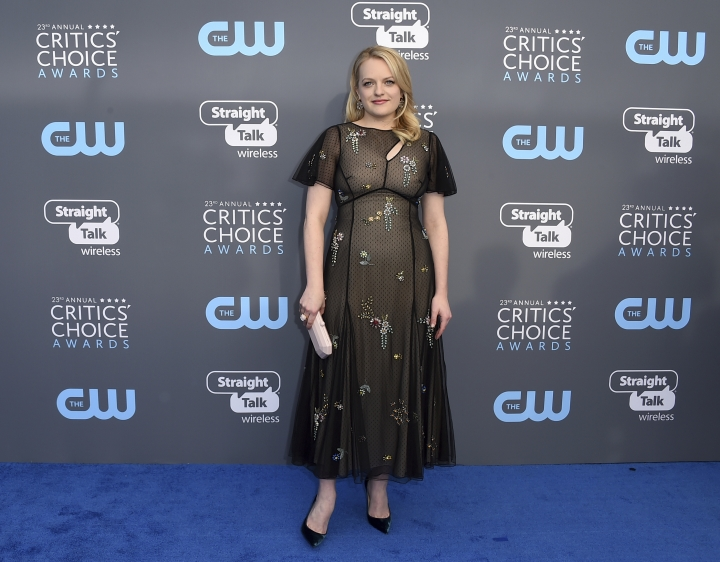 Elisabeth Moss arrives at the 23rd annual Critics' Choice Awards at the Barker Hangar on Thursday, Jan. 11, 2018, in Santa Monica, Calif. (Photo by Jordan Strauss/Invision/AP)