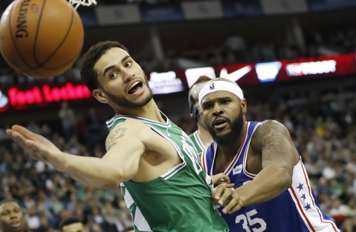 Boston Celtics forward Abdel Nader, left, reaches out for the ball during an NBA basketball game between the Boston Celtics and the Philadelphia 76ers at the O2 Arena in London, Thursday, Jan. 11, 2018. (AP Photo/Kirsty Wigglesworth)