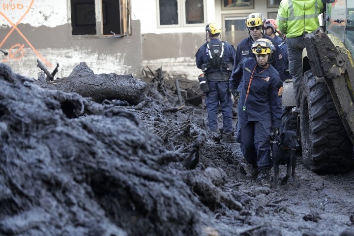 Emergency workers search areas damaged from storms in Montecito, Calif., Thursday, Jan. 11, 2018. Rescue workers slogged through knee-deep ooze and used long poles to probe for bodies Thursday as the search dragged on for victims of the mudslides that slammed this wealthy coastal town. (AP Photo/Marcio Jose Sanchez)