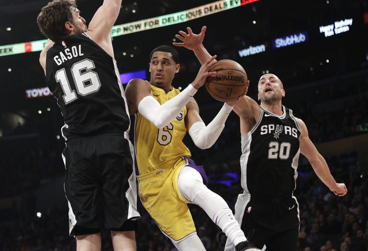 Los Angeles Lakers' Jordan Clarkson, center, is double-teamed by San Antonio Spurs' Pau Gasol, left, of Spain, and Manu Ginobili, of Argentina, during the first half of an NBA basketball game Thursday, Jan. 11, 2018, in Los Angeles. (AP Photo/Jae C. Hong)