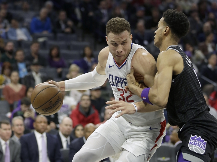 Los Angeles Clippers forward Blake Griffin, left, goes to the basket against Sacramento Kings forward Skal Labissiere during the first quarter of an NBA basketball game Thursday, Jan. 11, 2018, in Sacramento, Calif. (AP Photo/Rich Pedroncelli)