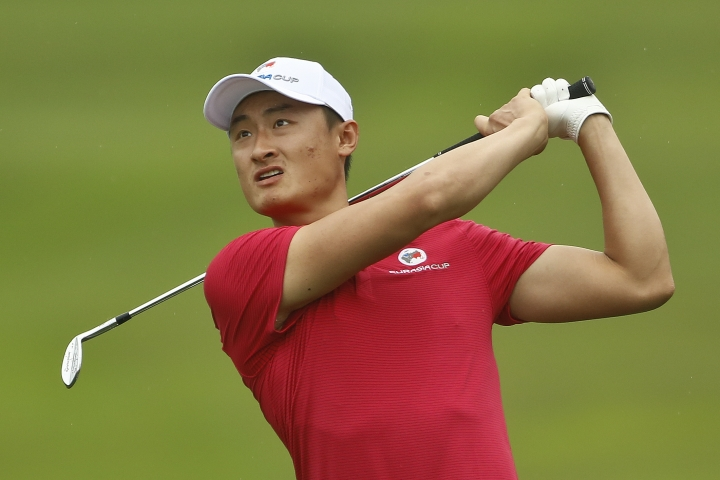 Li Haotong of China watches his shot on the 8th hole during the four-ball matches of the 2018 EurAsia Cup golf tournament at Glenmarie Golf & Country Club in Shah Alam, Malaysia, Friday, Jan. 12, 2018. (AP Photo/Sadiq Asyraf)