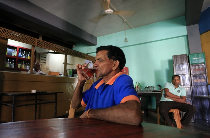 A Sri Lankan man sips an alcoholic drink at a bar in Colombo, Sri Lanka, Friday, Jan. 12, 2018. Sri Lanka has revoked a 38-year ban on selling alcohol to women and employing them in places where the brews are produced and sold. (AP Photo/Eranga Jayawardena)