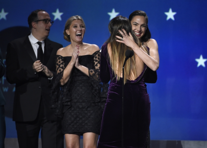 "Gal Gadot and Patty Jenkins embrace as ""Wonder Woman"" wins the award for best action movie at the 23rd annual Critics' Choice Awards at the Barker Hangar on Thursday, Jan. 11, 2018, in Santa Monica, Calif. (Photo by Chris Pizzello/Invision/AP)"