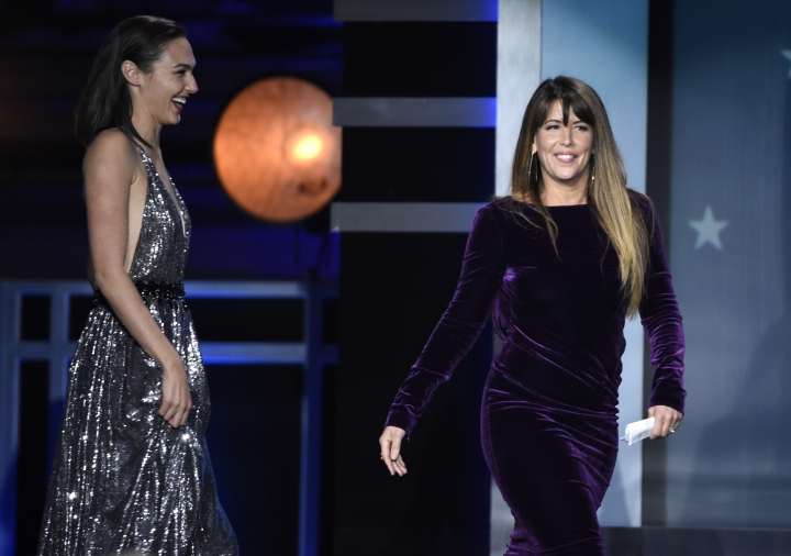 """Gal Gadot, left, and Patty Jenkins walk on stage to accept the award for best action movie for """"Wonder Woman"""" at the 23rd annual Critics' Choice Awards at the Barker Hangar on Thursday, Jan. 11, 2018, in Santa Monica, Calif. (Photo by Chris Pizzello/Invision/AP)"""