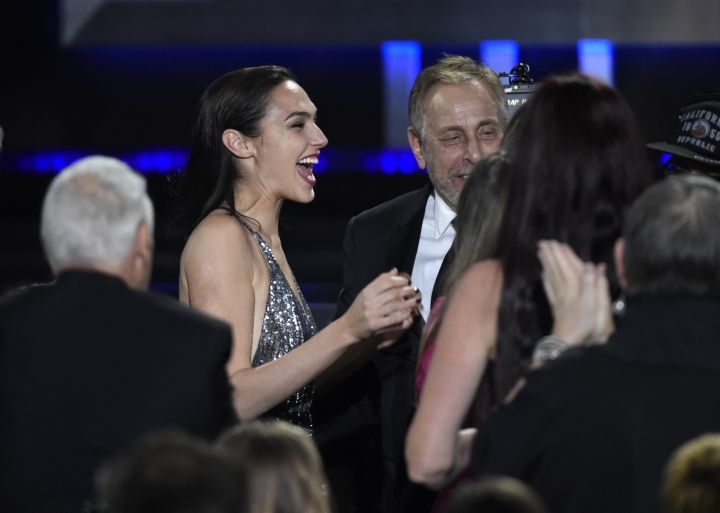 "Gal Gadot reacts in the audience as ""Wonder Woman"" wins for best action movie at the 23rd annual Critics' Choice Awards at the Barker Hangar on Thursday, Jan. 11, 2018, in Santa Monica, Calif. (Photo by Chris Pizzello/Invision/AP)"